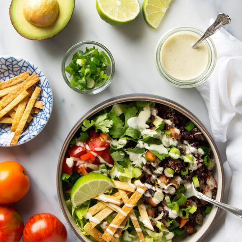 Quinoa Taco Salad with Garlicky Cashew Cream Dressing | picklesnhoney.com #vegan #quinoa #taco #salad #lunch #dinner