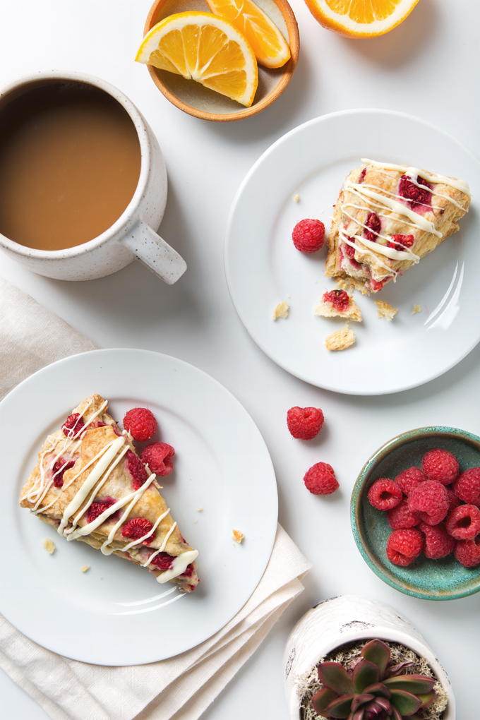 Simple Vegan Raspberry Scones with White Chocolate Drizzle | picklesnhoney.com #vegan #raspberry #scones #recipe #breakfast #brunch #whitechocolate