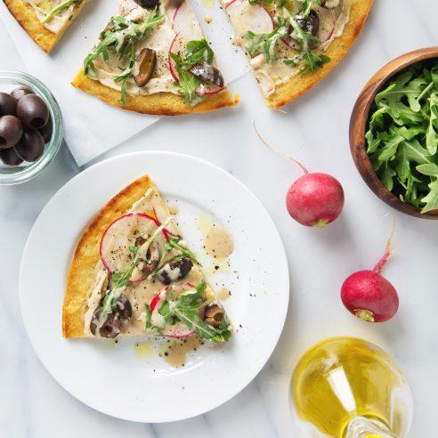 Simple Spring Socca Pizza (Vegan & GF) Only 8 ingredients + 25 minutes to make!   picklesnhoney.com #socca #pizza #vegan #glutenfree #recipe
